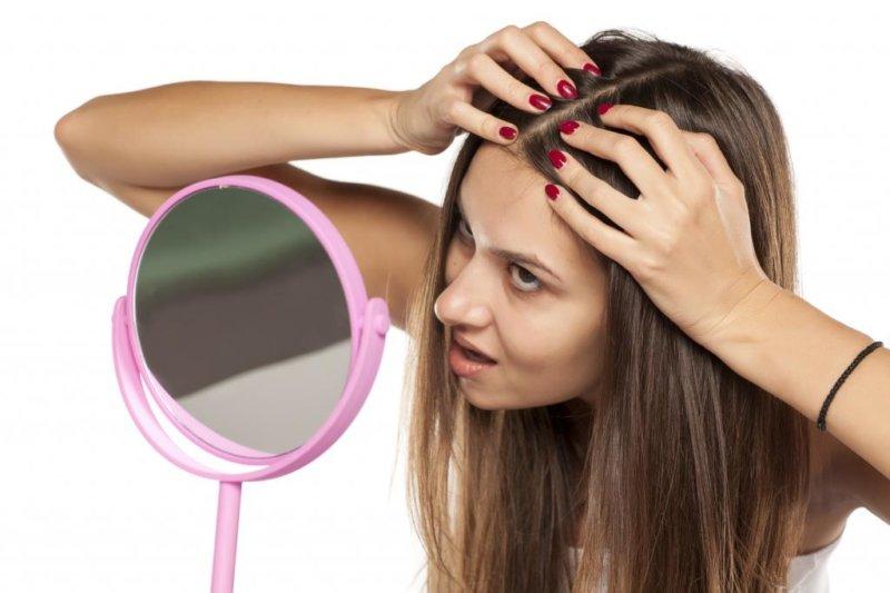 Появление прыщей в волосах